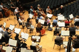Nierenberg conducts the Jacksonville Symphony during a session